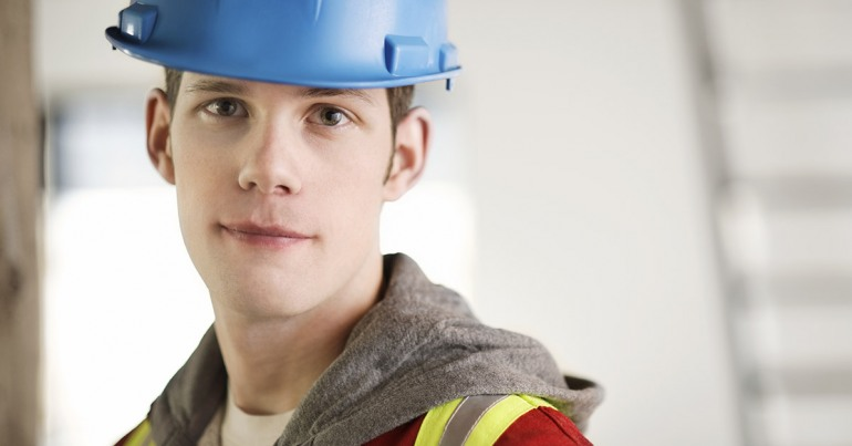 Young worker with safety hat and vest