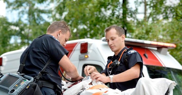 Emergency services sector: Paramedics transport a patient