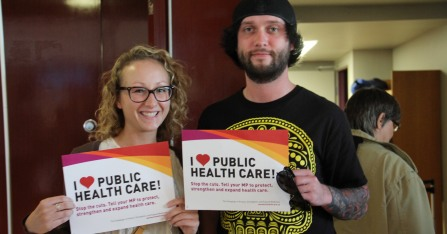 """CUPE members holding """"I <3 Public Health Care"""" signs"""