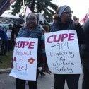 Image:  Striking members of CUPE 4914