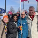 Group of CUPE Ontario activists standing together with flag