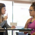 Female speech therapist helping a teenager