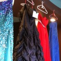 Multi-coloured formal dresses hanging in a row