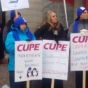 Group of women in winter clothing holding CUPE signs